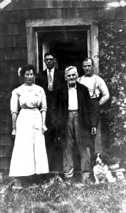 Bernard Ward,  right, behind Moses Ireland, with Bernard's niece Sadie Howard, the Bold Point postmistress.