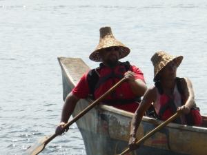 The helmsman in the We-Wai-Kai people's impressive canoe.