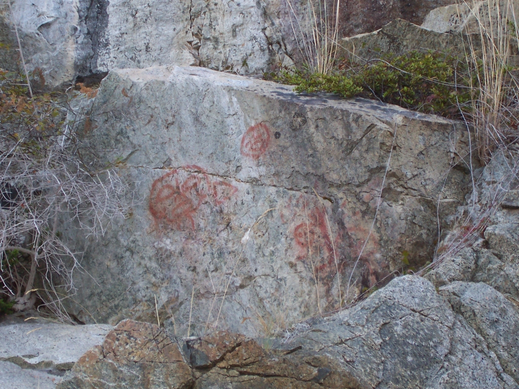 This panel of faces in Whiterock Pass between Read and Maurelle Islands includes a female sized hand print above the bottom right side image.