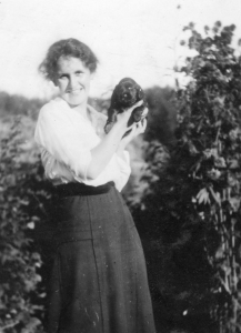 Katie Walker, age 25, with her first dog. Museum at Campbell River 6781.