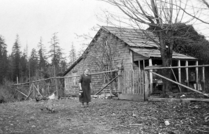 Mary Bryant outside her cabin c. 1935. Photo courtesy Museum at Campbell River, photo #6825.